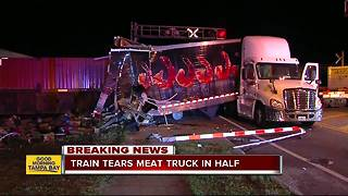 Train crashes into tractor-trailer stalled on tracks in Lakeland - Video