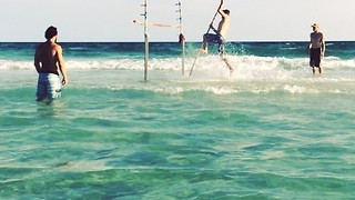 Man Pole Vaults in Sea, Surrounded by Captive Audience - Video