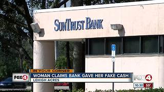 Woman says SunTrust gave her counterfeit money - Video