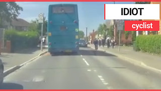 Teenage cyclist overtakes bus and cycles headfirst into moving car