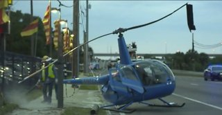 Surveillance video shows helicopter crash in Tampa