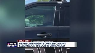 Dearborn Heights police officer caught on video sleeping in his cruiser - Video