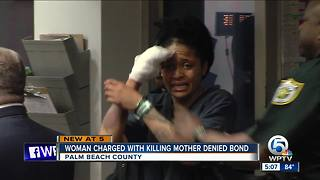 Woman charged with killing mom