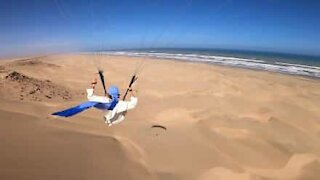 Paraglider flies over stunning Moroccan beach