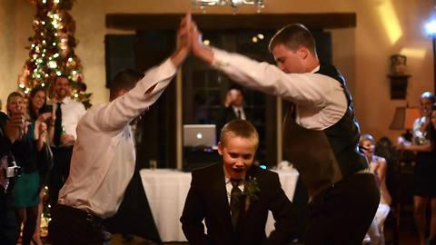 Groom and best friend light up wedding dance floor