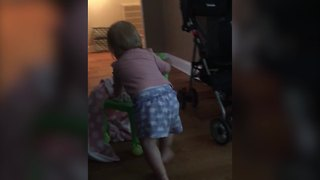 Cute Tot Girl Flips Over A Little Chair - Video