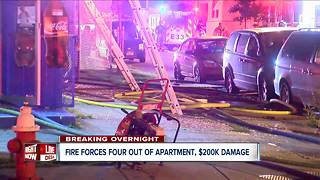 Four people forced from their apartment by overnight fire - Video