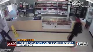 Thief hands out donuts during robbery - Video