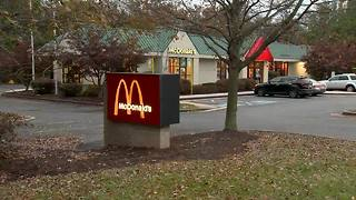 Woman breaks into McDonald's drive-thru window - Video