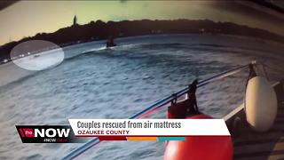 Couple rescued from air mattress - Video