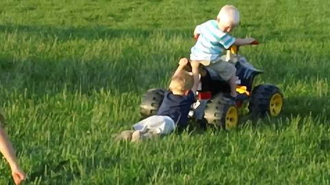 Boy Test His Strength While Pushing His Power Wheels