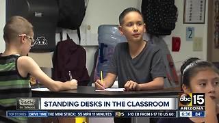 Donated desks help students stand in class