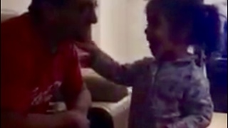 Adorable little girl sings to her Daddy