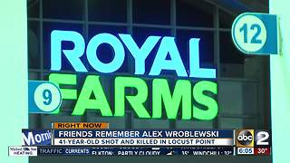 Police investigating murder behind Royal Farms in Locust Point - Video