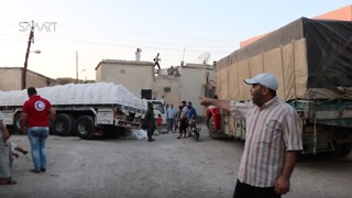 International Aid Convoy Arrives in Opposition-Controlled Northern Homs Province - Video