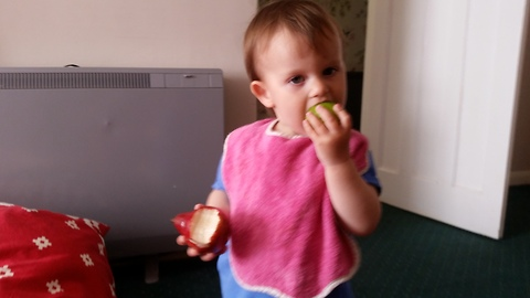 Cute baby eating a lime and a pear!