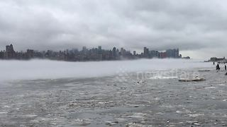 Manhattan appears to float on a cloud - Video