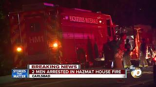 Two men arrested in hazmat house fire - Video
