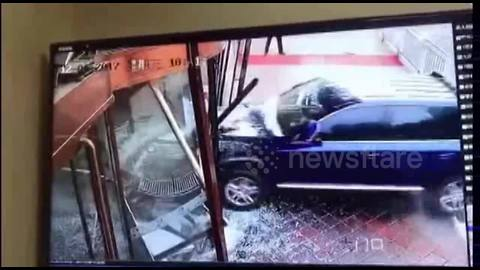 SUV smashes into hotel as driver presses accelerator by mistake