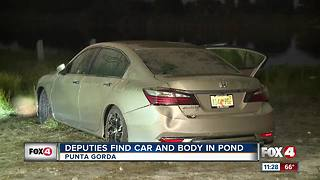 Body recovered from car submerged in pond - Video