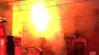 Toronto Firefighters Respond as Large Fire Engulfs Townhouse - Video