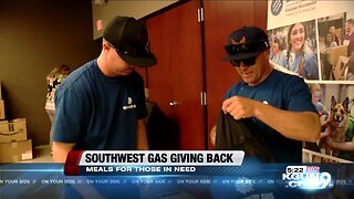 Southwest Gas employees hand out meals to homeless