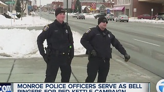 Monroe police officers serve as bell ringers for Salvation Army Red Kettle campaign - Video