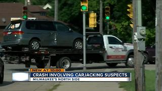 Driver struck by stolen van on north side - Video