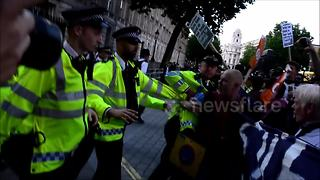 Hundreds march on Downing Street and call for Theresa May to step down - Video