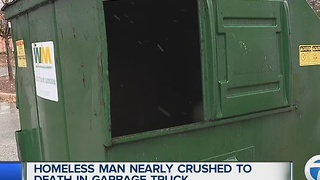 Homeless man nearly crushed to death by in garbage truck - Video