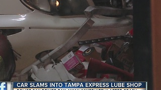 Car slams into Tampa express lube shop - Video