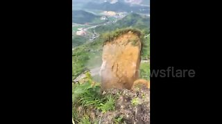 Huge section of mountainside collapses after heavy rain - Video