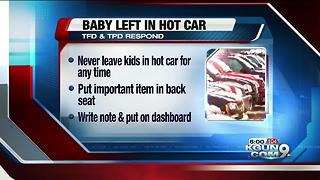 Authorities respond to reports of baby locked in car - Video