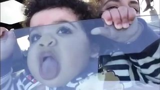 Little girl hysterically licks car window