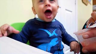 Baby has very funny response to eating apple sauce - Video