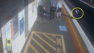 Horrifying moment tiny baby thrown onto train tracks after pram drifts off platform - Video