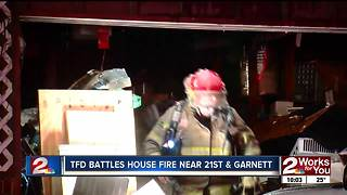 Tulsa firefighters battle house fire and cold temps - Video
