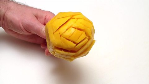 Learn how to make a mango rose in one minute