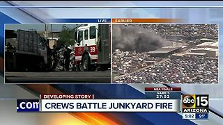 Fire crews battle first-alarm fire at a junkyard in Phoenix - Video