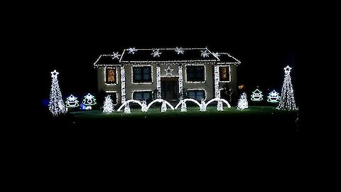 Fun Christmas song set to epic home light show