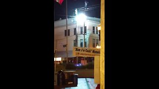 Malfunctioning electrical transformer explodes in front of scared onlookers - Video