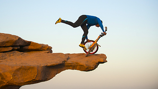 This Old Man Performs Clifftop BMX Yoga 300ft Above Ground