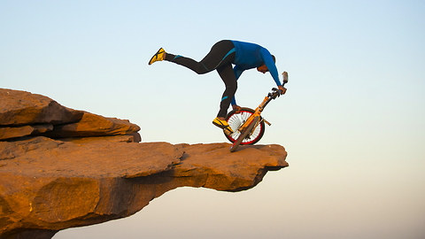 Clifftop BMX Yoga: Extreme 68-year-old Performs On Bike 300ft Above Ground