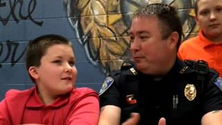 Officer adopts boy he rescued - Video