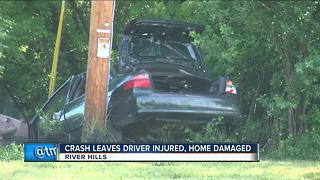 River Hills car crash leaves 1 person injured, home damaged - Video