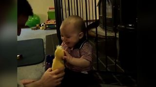 Baby's reaction to classic childhood game will definitely make you smile! - Video