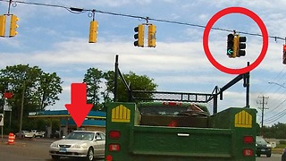 Careless driver cuts off truck while running a red light  - Video