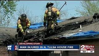 Man seriously injured after escaping house fire - Video