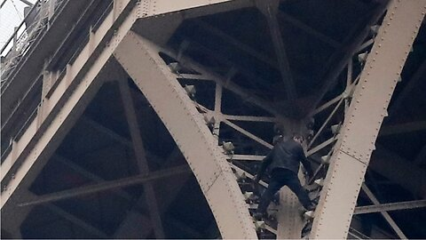 Man climbing Eiffel Tower convinced to come down and given to authorities