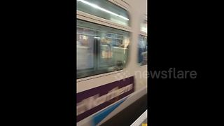 Train reverses back into UK station after failing to stop - Video